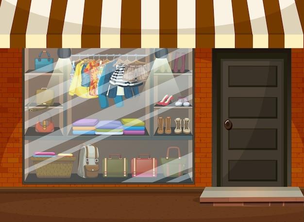 Frente del escaparate de la tienda de ropa con ropa y accesorios.