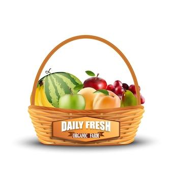 Frutas frescas en cesta de mimbre aislado en blanco