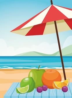 Frutas y sombrillas en la playa