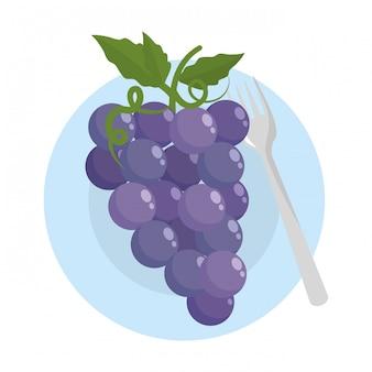 Frutas uvas aisladas con hojas