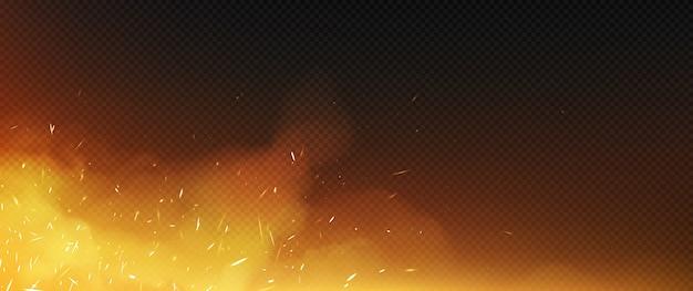 El fuego chispea con humo y partículas voladoras