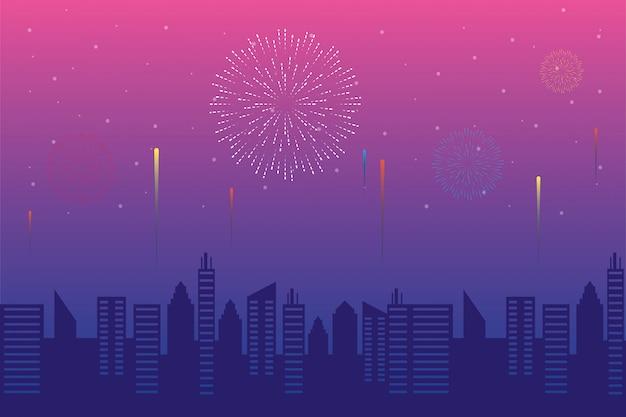 Fuegos artificiales estallan explosiones con paisaje urbano en fondo de cielo rosa