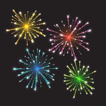 Fuegos artificiales estallando en diversas formas brillantes pictogramas contra fondo negro