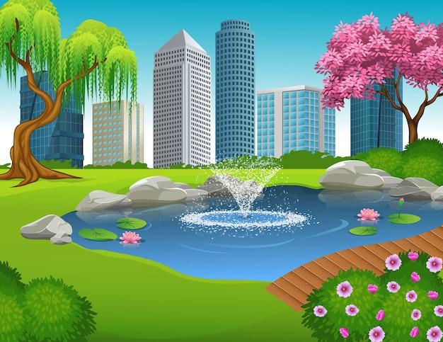 Fuente de agua hermosa del estanque en el fondo de la gran ciudad