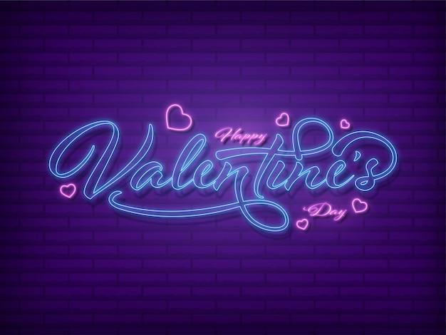 Fuente de feliz día de san valentín con efecto neón con corazones decorados sobre fondo de pared de ladrillo púrpura