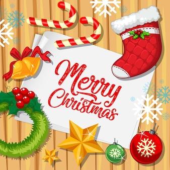 Fuente feliz navidad en papel con objetos navideños vista desde arriba