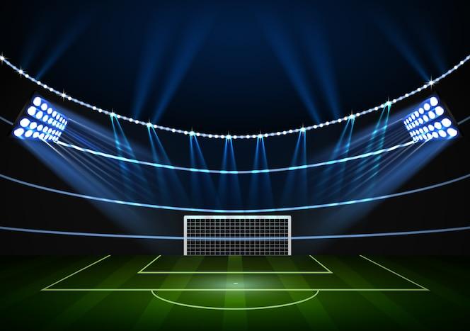 Fútbol en el campo del estadio con luz de escenario