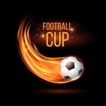 Fútbol volador en llamas. balón de fútbol con rastro de llama brillante sobre fondo negro