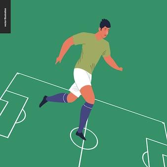 Futbolista europeo en campo de fútbol verde