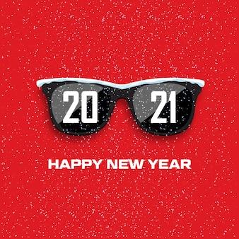 Gafas negras sobre fondo de nevadas. feliz año nuevo y feliz navidad.