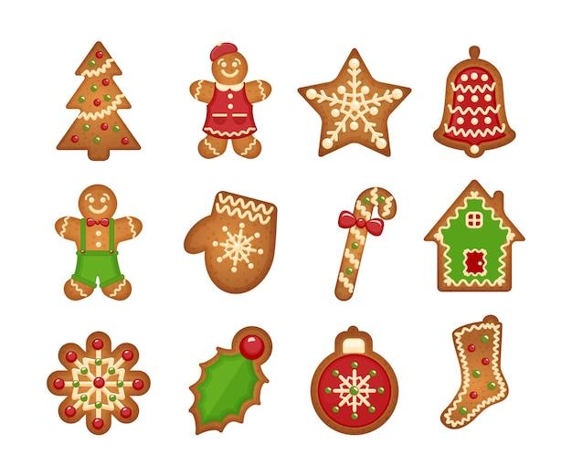 Galletas de jengibre de navidad sobre fondo blanco. árbol de navidad y estrella, campana y casa.