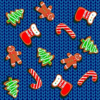 Galletas de jengibre de navidad sobre un fondo de punto.