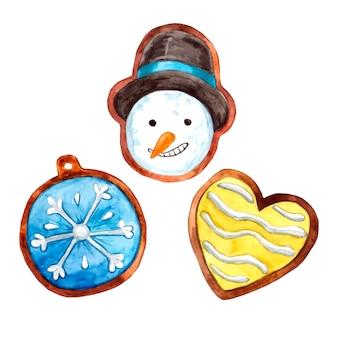 Galletas de jengibre pintadas en acuarela en forma de muñeco de nieve, escuchar y copo de nieve para las vacaciones de navidad