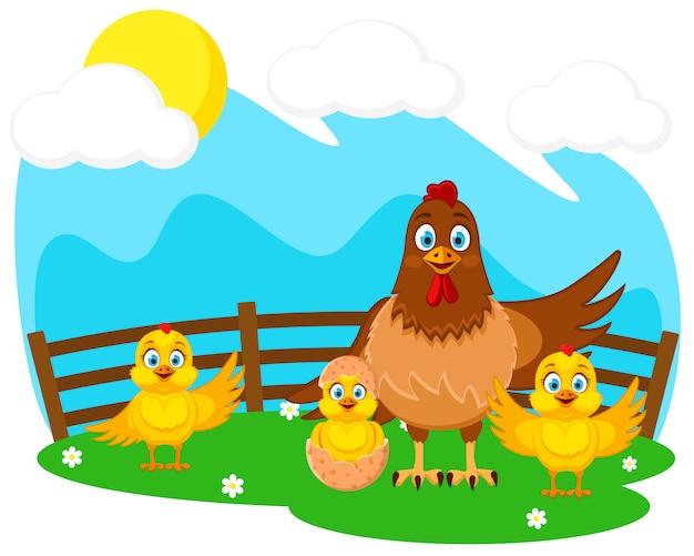 Gallina y pollitos en el césped verde. granja