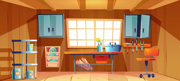 Garaje interior con banco de trabajo y herramientas.