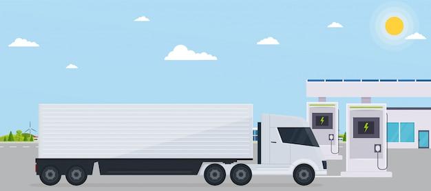Gasolinera electro con camión en ciudad ecológica de fondo.