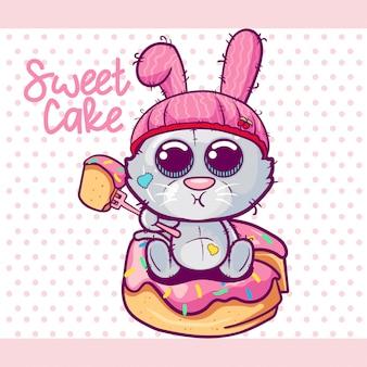 Gatito lindo de la historieta con una torta dulce.