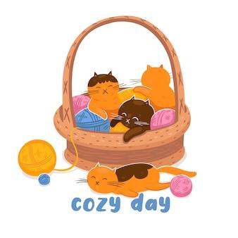 Gatitos y ovillos en una canasta y la inscripción día acogedor.