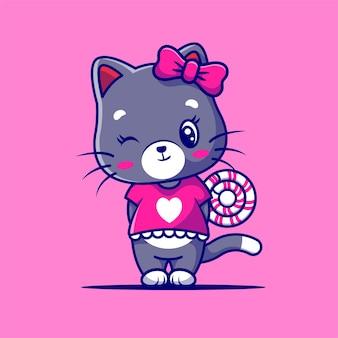Gato linda chica con caramelo dulce aislado en púrpura