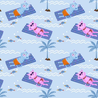 Gato lindo que flota en el colchón del agua de la piscina del aire.