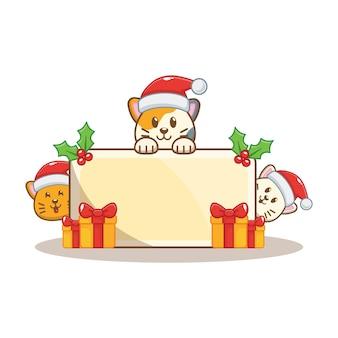 Gato de navidad con tarjeta de felicitación