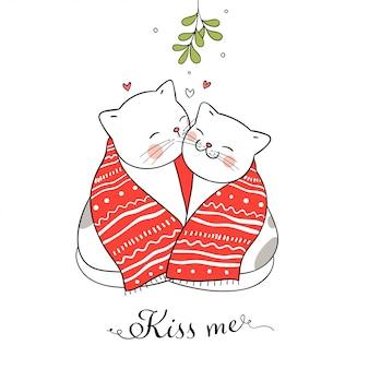 Gatos besándose bajo un muérdago