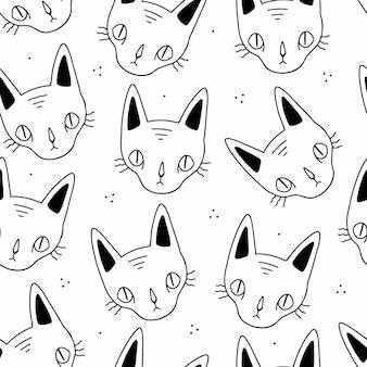 Gatos de dibujos animados de doodle blanco y negro sin costura se enfrenta a patrones sin fisuras sobre un fondo blanco