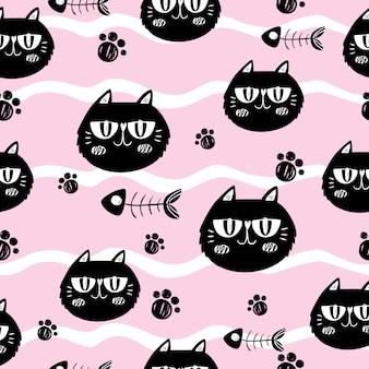 Gatos y espinas de pescado sobre fondo rosa
