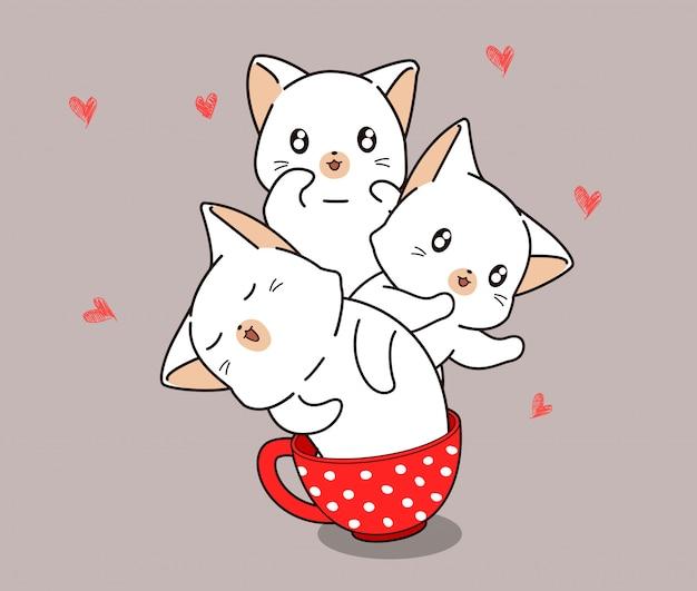 Gatos kawaii dentro de una taza