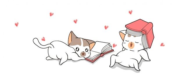 Los gatos lindos dibujados a mano están leyendo libros