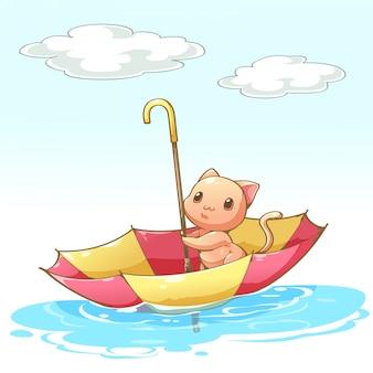 Gatos sentados en el paraguas flotando por el agua