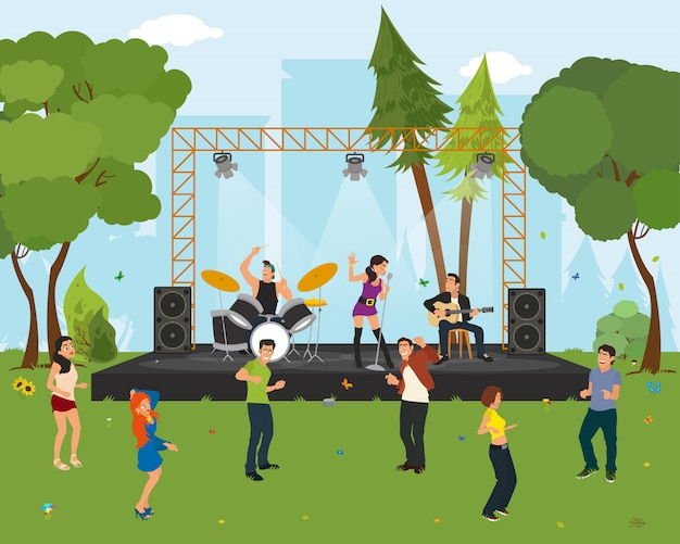 Gente bailando en el parque de la ciudad en el concierto.