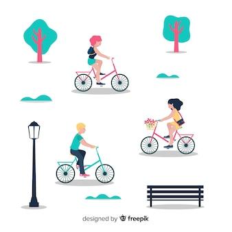 Gente en bicicleta por el parque