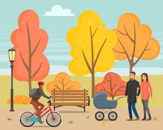 Gente caminando en el parque otoño con niño o bicicleta