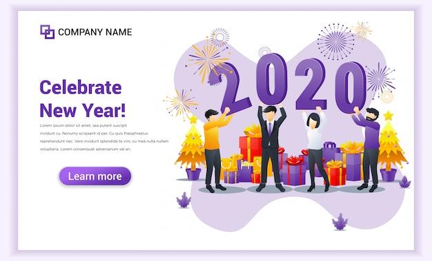 La gente celebra el año nuevo cerca sosteniendo los símbolos de la página de inicio de 2020