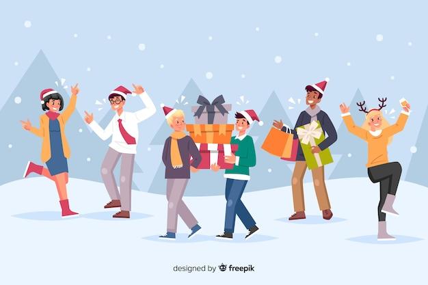 Gente celebrando la navidad y ofreciendo regalos