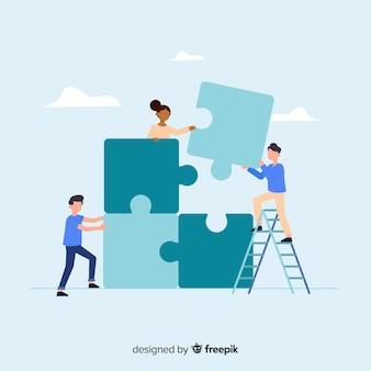 Gente colaborando para hacer un puzzle