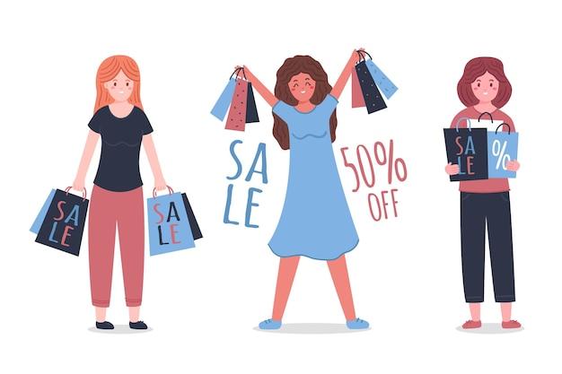 Gente comprando y sosteniendo bolsas.