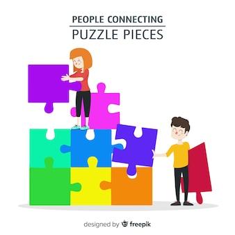 Gente conectando piezas de puzle