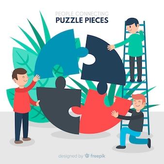 Gente conectando piezas de puzzle