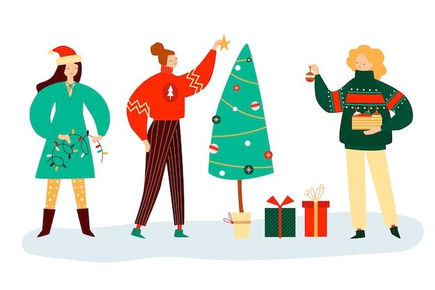 Gente decorando árbol festivo