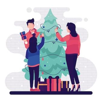 Gente decorando el árbol de navidad con luces de cadena y regalos