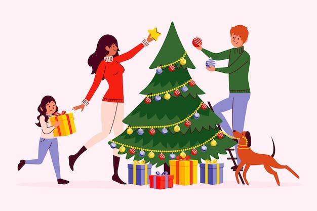 Gente decorando el árbol de navidad