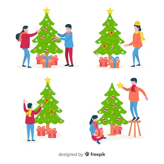 Gente decorando árboles de navidad