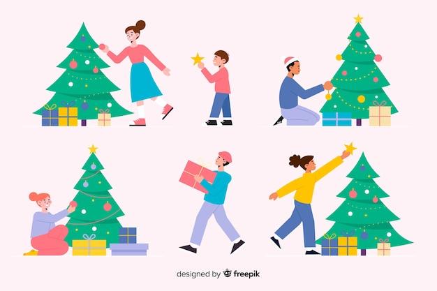 Gente decorando diseño plano del árbol de navidad