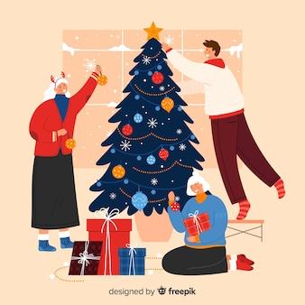 Gente decorando juntos el árbol de navidad
