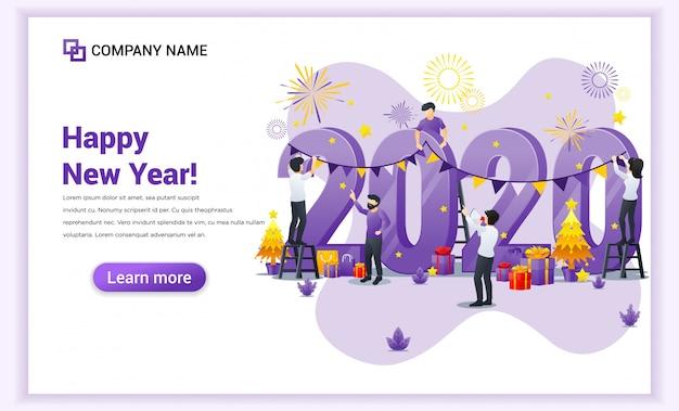 Gente decorando en el número gigante 2020 celebrando el estandarte de la víspera de año nuevo