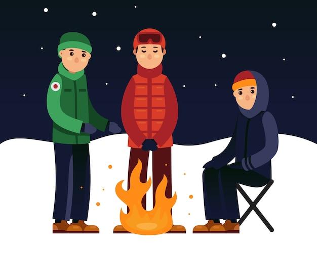 Gente disfrutando fuego en la nieve