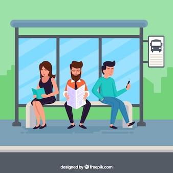 Gente esperando al autobús con diseño plano