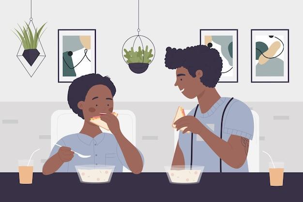 La gente de la familia feliz come la comida de la cena en el interior de la cocina hablando sentado en la mesa